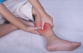 Причины болей в ногах